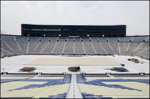 A platform for the hockey rink is laid over the football field for the upcoming Winter Classic at Michigan Stadium in Ann Arbor. The Red Wings will host the Maple Leafs at the stadium on New Year's Day.