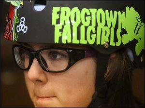 Breonna Matney, 12, sports a helmet bearing the name of her team.