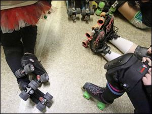 Roller skates and tutus are the usual fare during practice with the Frogtown Fallgirls.