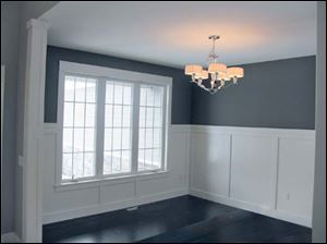 The formal dining room's tall wainscoting is classic.