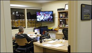 University of Toledo men's basketball coach Tod Kowalczyk watches tapes of the Robert Morris basketball team in his office in Savage Arena. Kowalczyk watches game film late at night following each contest before he turns his attention to the Rockets' next opponent.