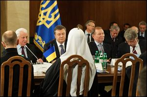 Ukraine's political, government, opposition and religious leaders at a round-table meeting, facing from left to right:  ex-president Leonid Kravchuk, current president Viktor Yanukpvych,  ex-president Leonid Kuchma, ex-president Viktor Yushchenko in Kiev, Ukraine today.