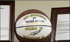 A commemorative basketball in his Savage Arena office celebrates Tod Kowalczyk's first victory as Toledo's coach in December, 2010.