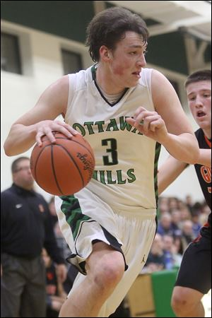 Ottawa Hills' Geoff Beans (3) drives the baseline during the second quarter Friday night against Gibsonburg. The 6-foot-7 senior forward scored 13 points and added five rebounds as the Green Bears won at home.