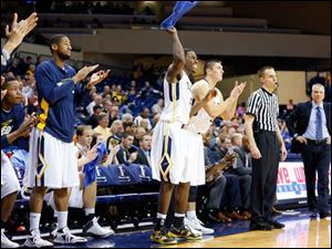 Toledo players cheer from the bench as the Rockets stretch their lead over Sam Houston State during the second half.