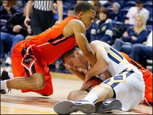 University of Toledo player Zach Garber (33) and Sam Houston State player Paul Baxter (21) fight for the ball during the second half.