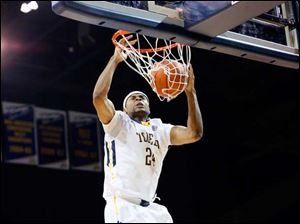 University of Toledo player J.D. Weatherspoon (24) dunks against Sam Houston State during the second half.
