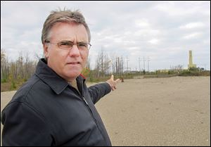 Neal Kelly, spokesman for Ontario Power Generation, stands in the area of the Bruce Power nuclear power complex in Kincardine, Ont., where the company proposes to drill a waste storage chamber.