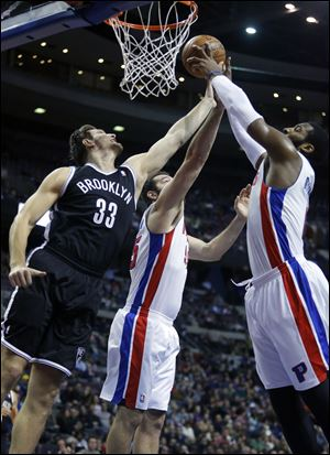 Brooklyn Nets forward Mirza Teletovic (33), Detroit Pistons forward Josh Harrellson (55) and center Andre Drummond (0) try to grab a rebound during the first half Friday in Auburn Hills, Mich.