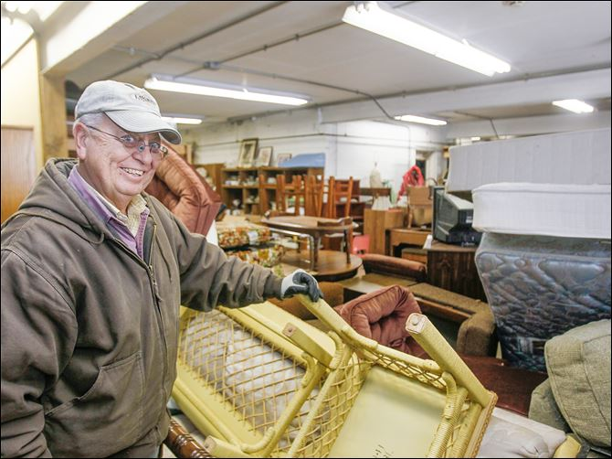 15n1sauder As director, Jerry Rohrs says he racks up more than 10,000 delivery miles a year as he hauls household goods to and from the Sauder warehouse in Archbold, Ohio, for the Furniture/Appliance Recycling Program.