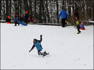 Bailey Davis, 12, of Toledo, snowboards at Pearson Metropark.