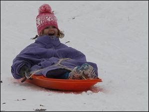 Breanna Williams, 4, of Toledo, riding down the hill at Pearson Metropark.