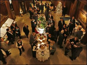 Guests enjoy the buffet at the Block Communications party at the Toledo Club.