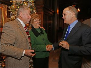 Tom Brady, left, and Mary Ellen Mazey chat with Allan Block at the Block Communications party at the Toledo Club.
