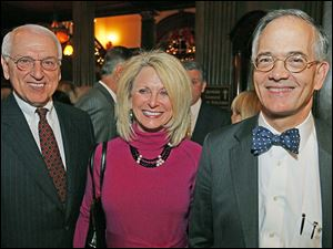 Dick and Shelly Walinski with John Robinson Block at the Block Communications party.