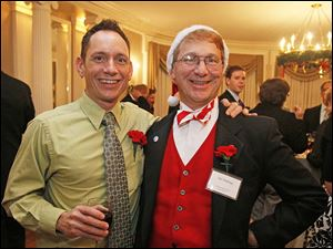 Bobby Boehler, left, and Ed Duling attended the 36th annual Holiday with a Heart Gayla for the LGBT Community and Friends.