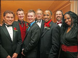 The 36th annual Holiday with a Heart Gayla for the LGBT Community and Friends, in Toledo. Hosts of the event include: Rick Cornett, left, Billy Mann, Andrew Larsen, Wayne North, Ricky Waugh, Steven Maenle, and Kenyetta White.