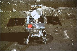 China's first moon rover, 'Jade Rabbit,' is seen on the lunar surface in an area known as Sinus Iridum — the Bay of Rainbows.