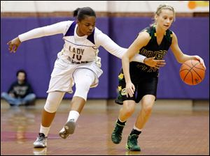 Clay's Kayla Schaefer (4) moves the ball against   Waite's Ramiyah Henry (10).