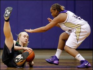 Clay's Morgan Connor (30) battles Waite's Dajanay Well (15) for a loose ball.