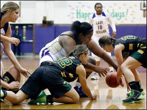 Clay's Samantha Enck (22) battles Waite's (30) for the ball during a basketball game Monday, 12/16/13, in Toledo, Ohio.