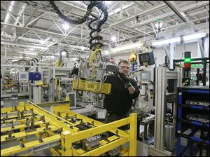 Jeff Roe works on a six-speed transmission. General Motors will invest in Toledo Transmission to upgrade its ability to make six-speed tran