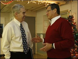 Ohio state Rep. Randy Gardner (6th District-R), left, congratulates retiring Rossford school board member Joseph Minarcin, Jr. for his 16 years of service on the board at the December meeting in Rossford, Ohio on December 21, 2009.