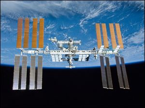 International Space Station is shown with the backdrop of Earth.