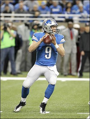 Detroit Lions quarterback Matthew Stafford looks downfield. He was intercepted three times on the night.