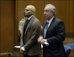 R&B singer Chris Brown, left, appears in court with his attorney Mark Geragos during a probation violation hearing in which his probation was revoked by a superior court judge Monday in Los Angeles.
