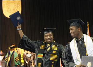 Eric Norvell II, left, and Taurean Young celebrate commencement at Savage Hall. Mr. Norvell of Elyria earned a bachelor of science in an individualized program, and Mr. Young of Dayton earned a bachelor of science in mechanical engineering.