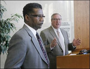 TPD Lt. William Moton, left, is introduced as chief of police by mayor-elect D. Michael Collins.