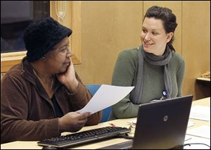 Veola Carpenter, left, seeks advice from Rachel Noleff, an outreach and enrollment worker for the Neighborhood Health Association, during a health-care forum at the Lagrange branch library.