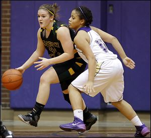 Clay's Hannah Novak (44) moves the ball against   Waite's Mia Rodregiz (11).
