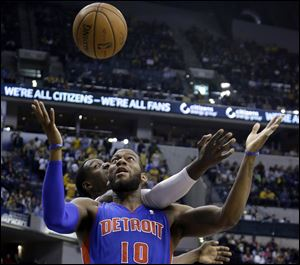 Indiana Pacers center Ian Mahinmi, back, comes from behind to knock the ball away from Detroit Pistons forward Greg Monroe in the first half Monday in Indianapolis.