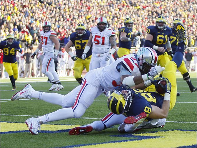 s3td Michigan's Jake Butt (88) lands in the end zone for a touchdown against Ohio State. The tight end has two scores this season.