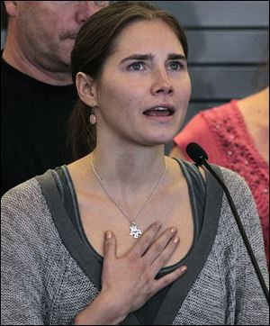 Amanda Knox speaks at a news conference shortly after her arrival from Italy at Seattle-Tacoma International Airport in Seattle in 2011.