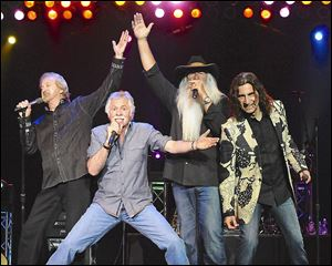 The Oak Ridge Boys, from left, Duane Allen, Joe Bonsall, William Lee Golden, and Richard Sterban celebrate 40 years as a group.