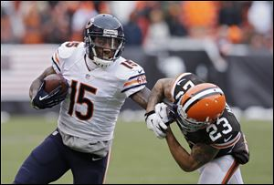 Bears wide receiver Brandon Marshall (15) pushes Browns cornerback Joe Haden (23) away after a catch in Cleveland's 38-31 loss to Chicago.