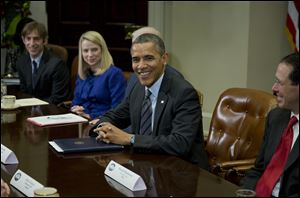 President Barack Obama meets with technology executives in the Roosevelt Room the White House in Washington, today.