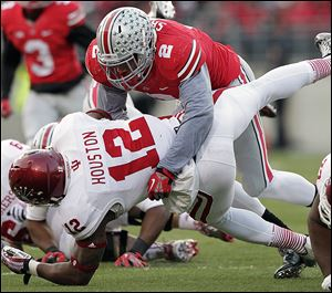Ohio State linebacker Ryan Shazier tackles Indiana running back Stephen Houston during Ohio State's November victory. Shazier led the Big Ten in tackles, earning him first-team All-American honors.