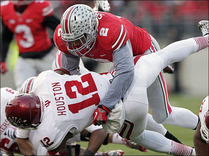 s4ryan-1 Ohio State linebacker Ryan Shazier tackles Indiana running back Stephen Houston during Ohio State's November victory. Shazier led the Big Ten in tackles, earning him first-team All-American honors.
