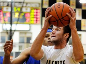 Perrysburg's Nate Patterson (43) goes to the net against Springfield's  Demajeo Wiggins (40).