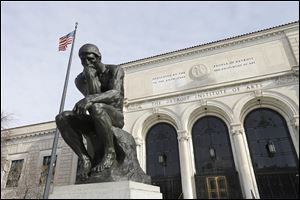 The Detroit Institute of Arts in Detroit, The Thinker, a sculpture by Auguste Rodin is seen outside the art museum.