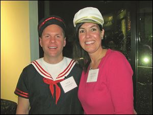 Nick and Jennifer Otersen dressed in nautical attire to volunteer and help out for the night.