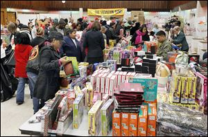 The United Auto Workers Local 12 hall on Ashland Avenue bustles with shoppers and volunteers during the Salvation Army's annual Christmas distribution.