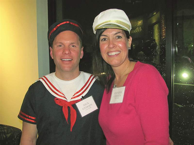 Nick-and-Jennifer-Otersen-dressed-in-nautical-attire-to-volunteer-and-help-out-for-the-night