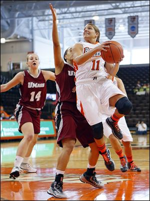 The Falcons' Jillian Halfhill drives past Massachusetts' Nola Henry during the first half Thursday at the Stroh Center. Halfhill scored seven points as BG rolled to a victory.