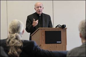 The Rev. Charles F. Ritter takes questions during a news conference for the announce-ment of his selection asadministrator of the Toledo Roman Catholic Diocese. Former Bishop Leonard Blair was installed Monday as the archbishopof Hartford, Conn.
