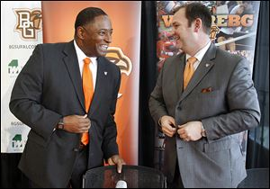 Dino Babers, left, is introduced by Falcons athletic director Chris Kingston after being named 18th football coach in BG history during a news conference Thursday at the Stroh Center.